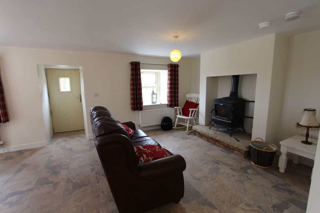 Living area with log burning stove, fuel provided
