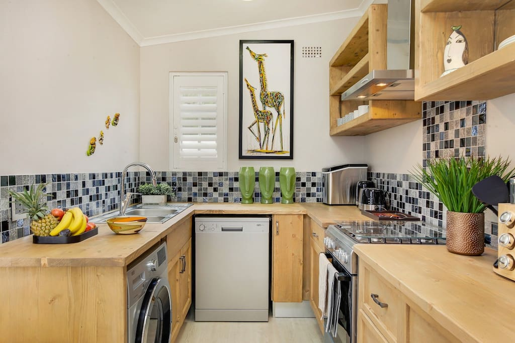 Fully furnished kitchen with washer-dryer and dishwasher