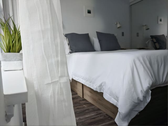 bright +inviting second bedroom with private balcony (note: blackout blinds are available)
