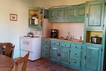 The kitchen. Traditional style adobe with hand plastered inter walls.