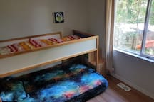 The second bedroom has the same memory gel double bed and a single foam mattress on the top bunk.  No closet in this room but there are ikea bins for you to use.  ~ Don't forget to ask us about our kids art & boredom packages *grin*