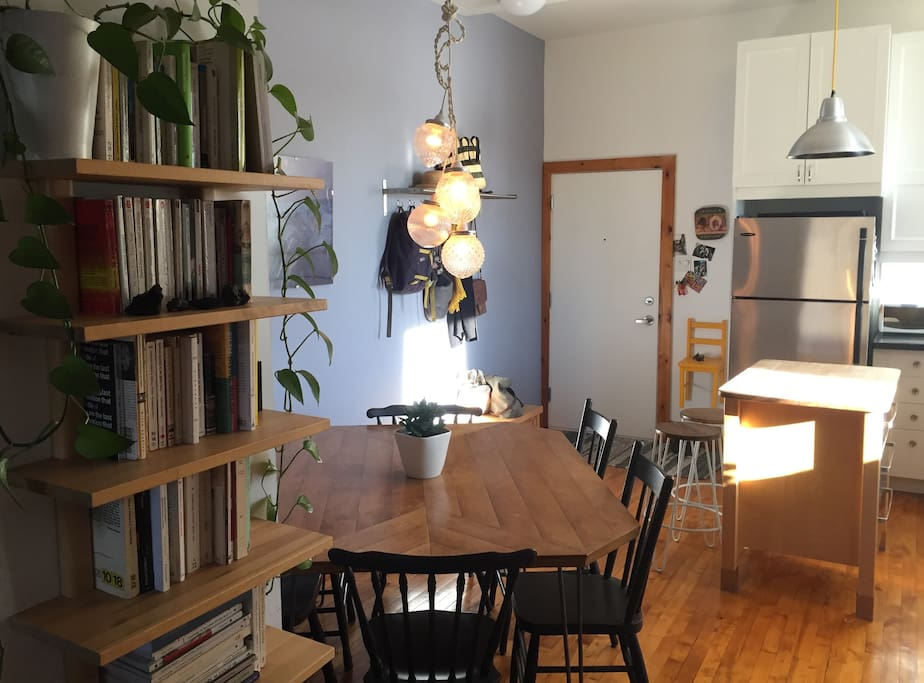 Bright kitchen with a dining table that fits comfortably 6 persons.