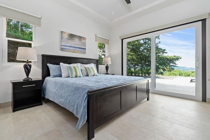 Master bedroom with view of pool, mountains & ocean