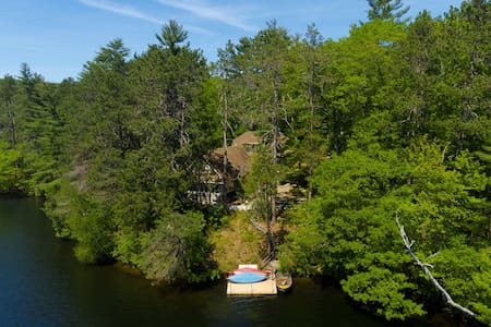 Two dog-friendly, lakefront cottages w/ hot tub, mountain views, and more!
