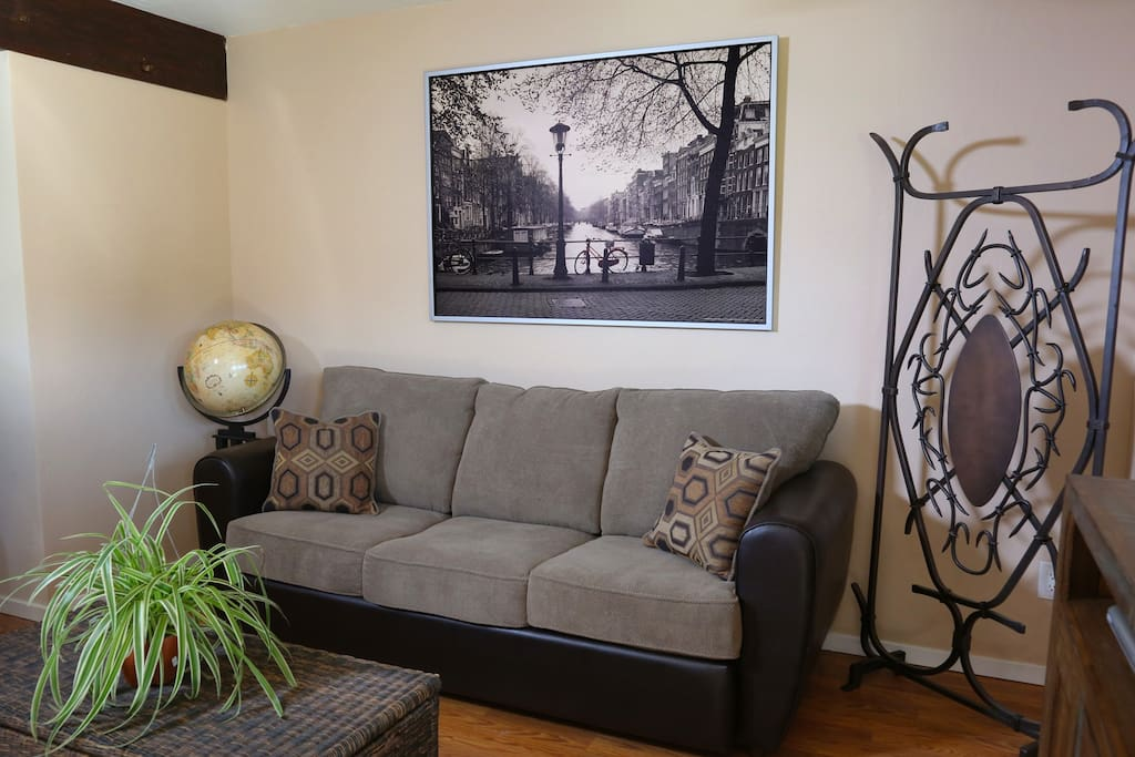 Very Cozy Living Room with a Queen Size Sleeper Sofa.  No Worries about springs on your back sleeping here with the upgrades of a Memory Foam Mattress!