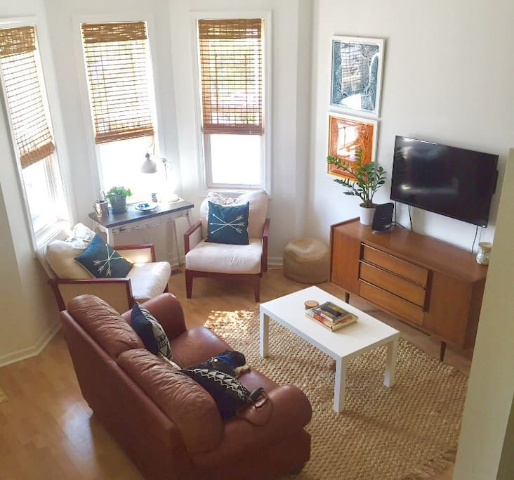 Living Room: natural light, love seat, Netflix and Roku, board games