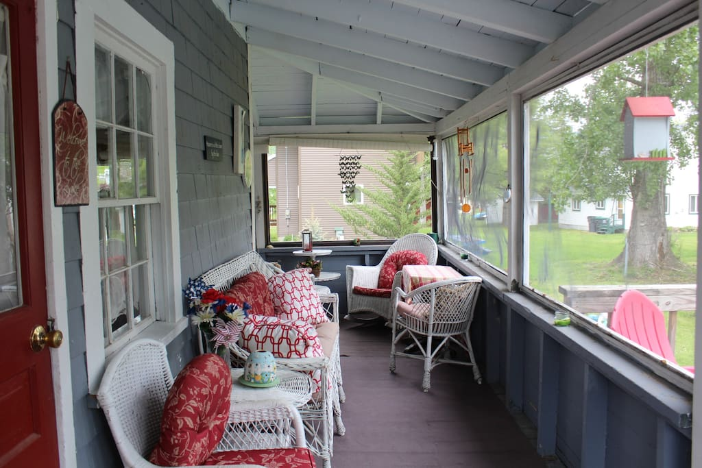 Side porch off deck with small table for dinning