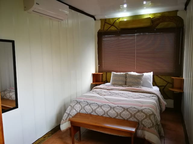 Comfortable double bed with A/C to keep you cool meanwhile you rest from the daily adventures that we can help you to program in our tour office :)