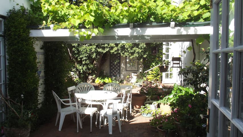 This beautiful vine covered patio is the perfect place to enjoy a glass of cold white wine after returning from a  day on the beach. Totally private with barbeque facilities there is always a breeze to keep you cool. There is a table and 8 chairs
