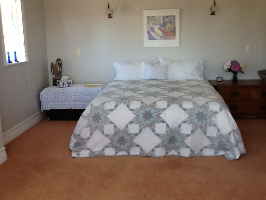 Large bedroom with sofa, queen size bed, cotton sheets and feather duvet or woollen blankets (your choice), four pillows