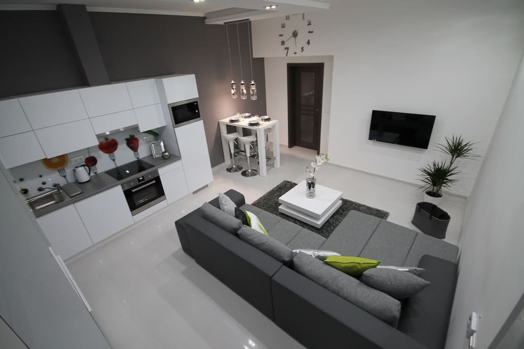 Open-air living room with kitchen. This big bed is comfortable for two people ( if we turn it to a bed 200x180 cm )