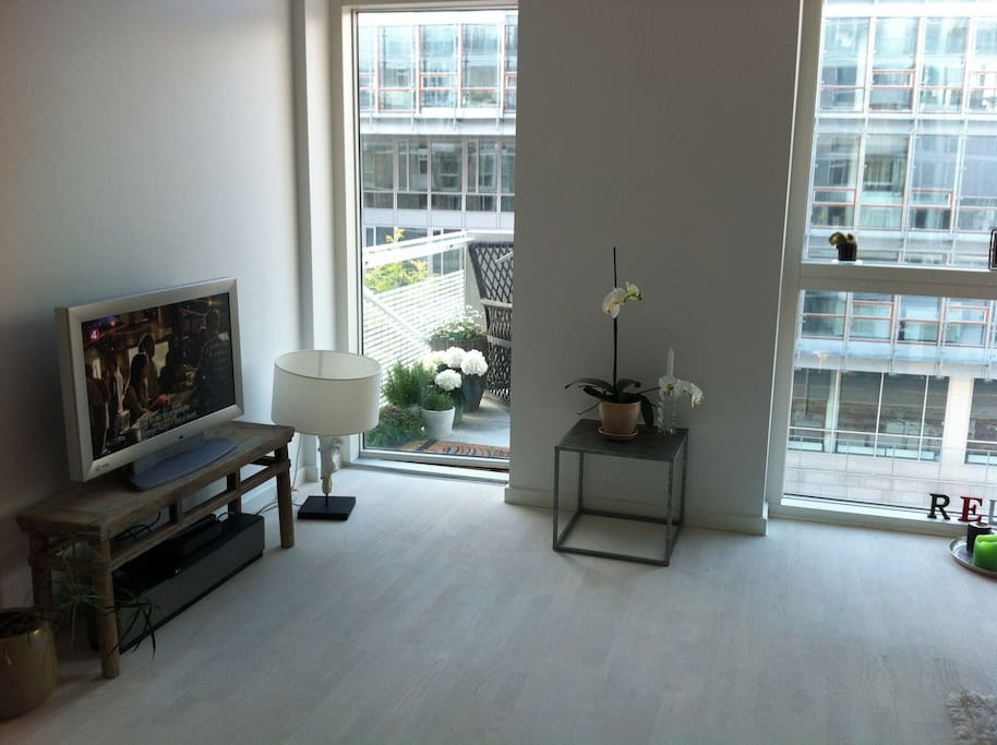 Living room with access to small balcony