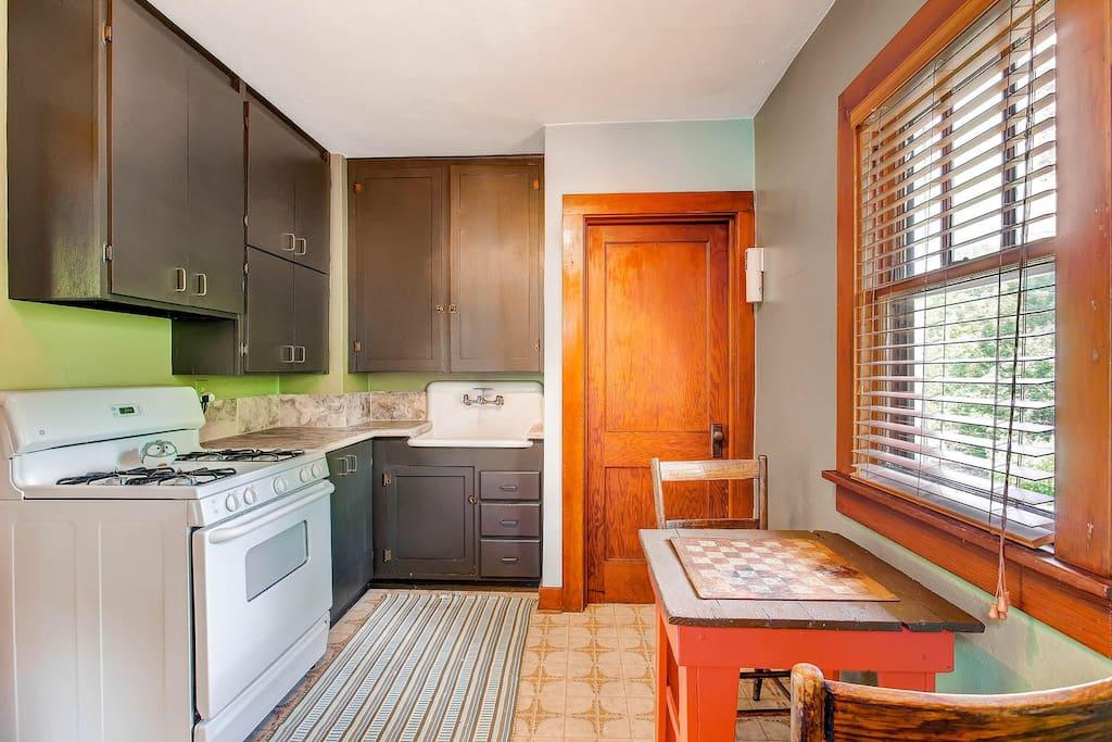 Kitchen has full size fridge and portable dishwasher.