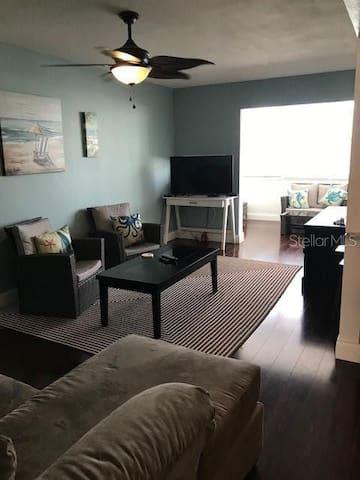Living room with added bonus room. Bonus room has a side view of the ocean.