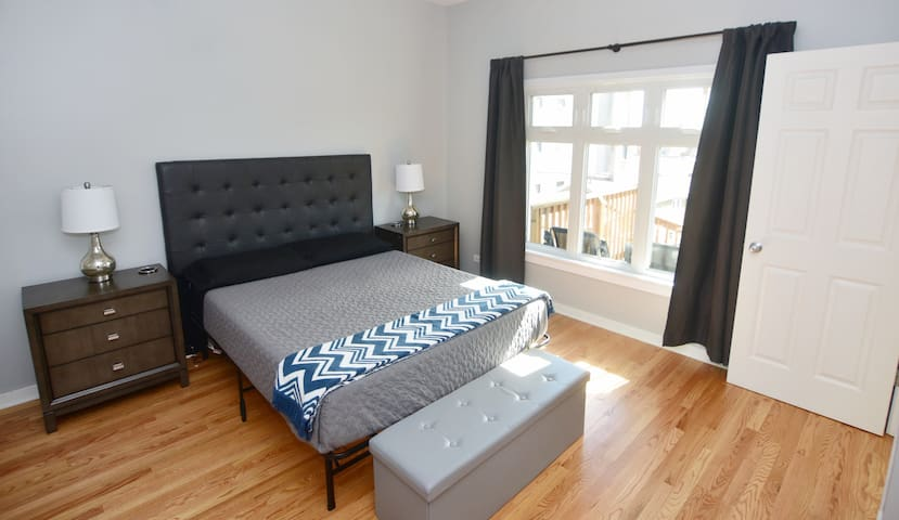 Spacious Master Bedroom Equipped with New Eight Brand Mattress.  Plenty of Natural Lighting with Picture Window.