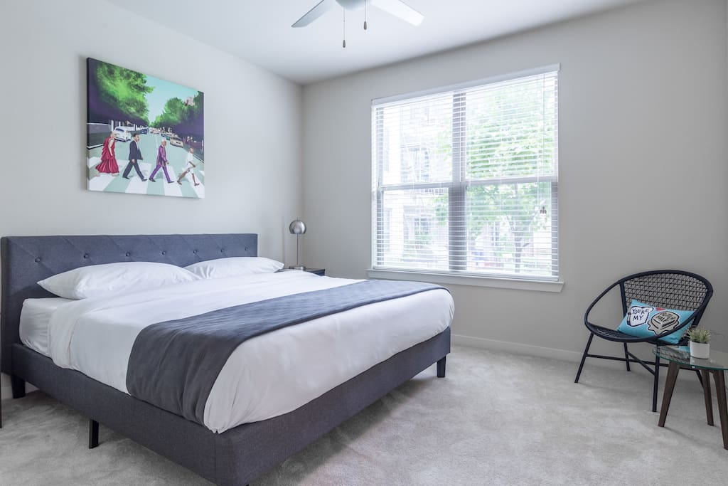 Spacious bedroom with a King bed and memory foam mattress, nightstands with USB connectors