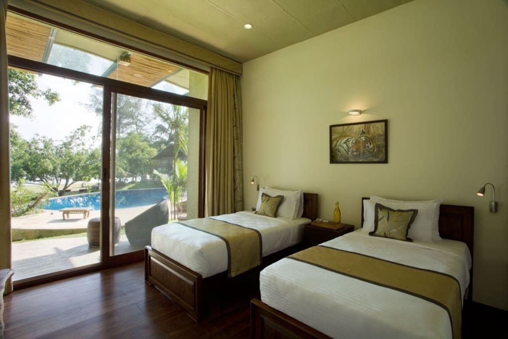 The twin bedded bedroom with pool view