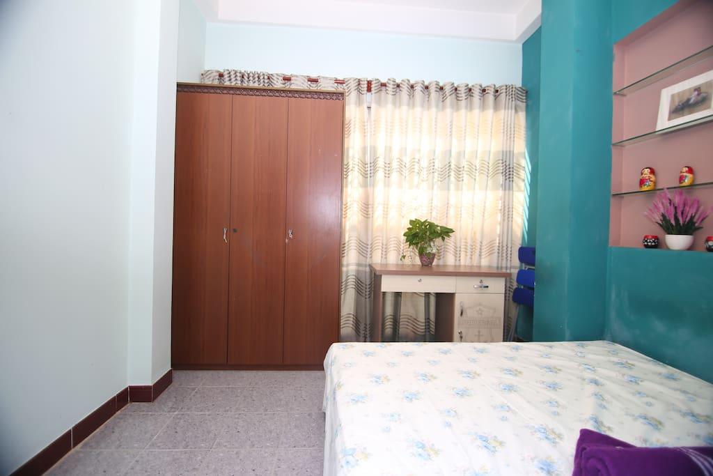 Bedroom with working desk
