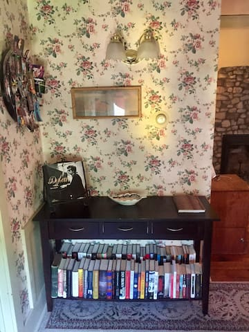 Upon entry, there is a shelf stocked with many books to relax with and enjoy during your stay.