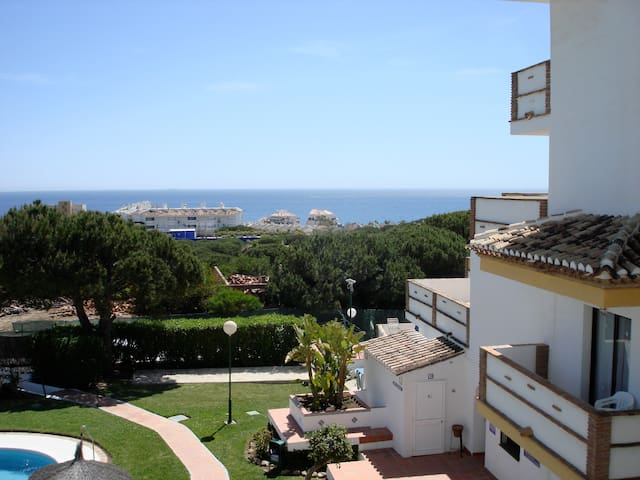 Enjoy a HEATED POOL and SEA VIEW apartment!