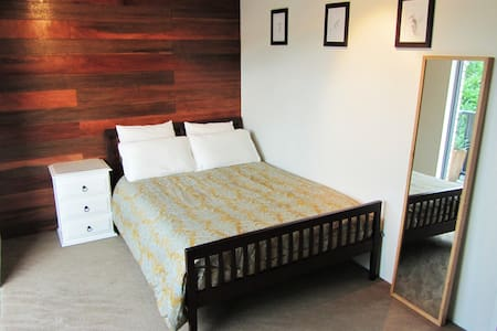 Comfy double bed in modern room. - Clayfield