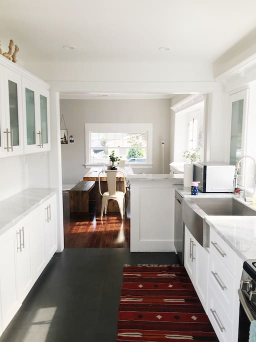 Large kitchen with garden sink, microwave, garbage disposal, stove and oven, washer and dryer. So many windows, light pours in from three sides of the home!
