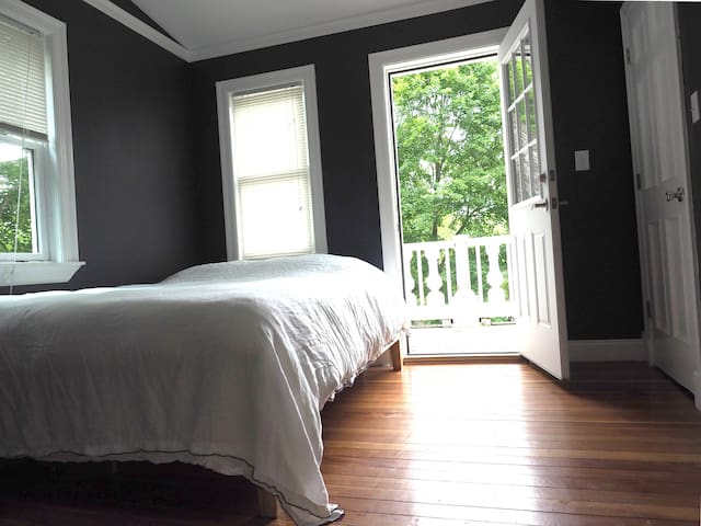 This is the first-floor bedroom, which has direct porch access