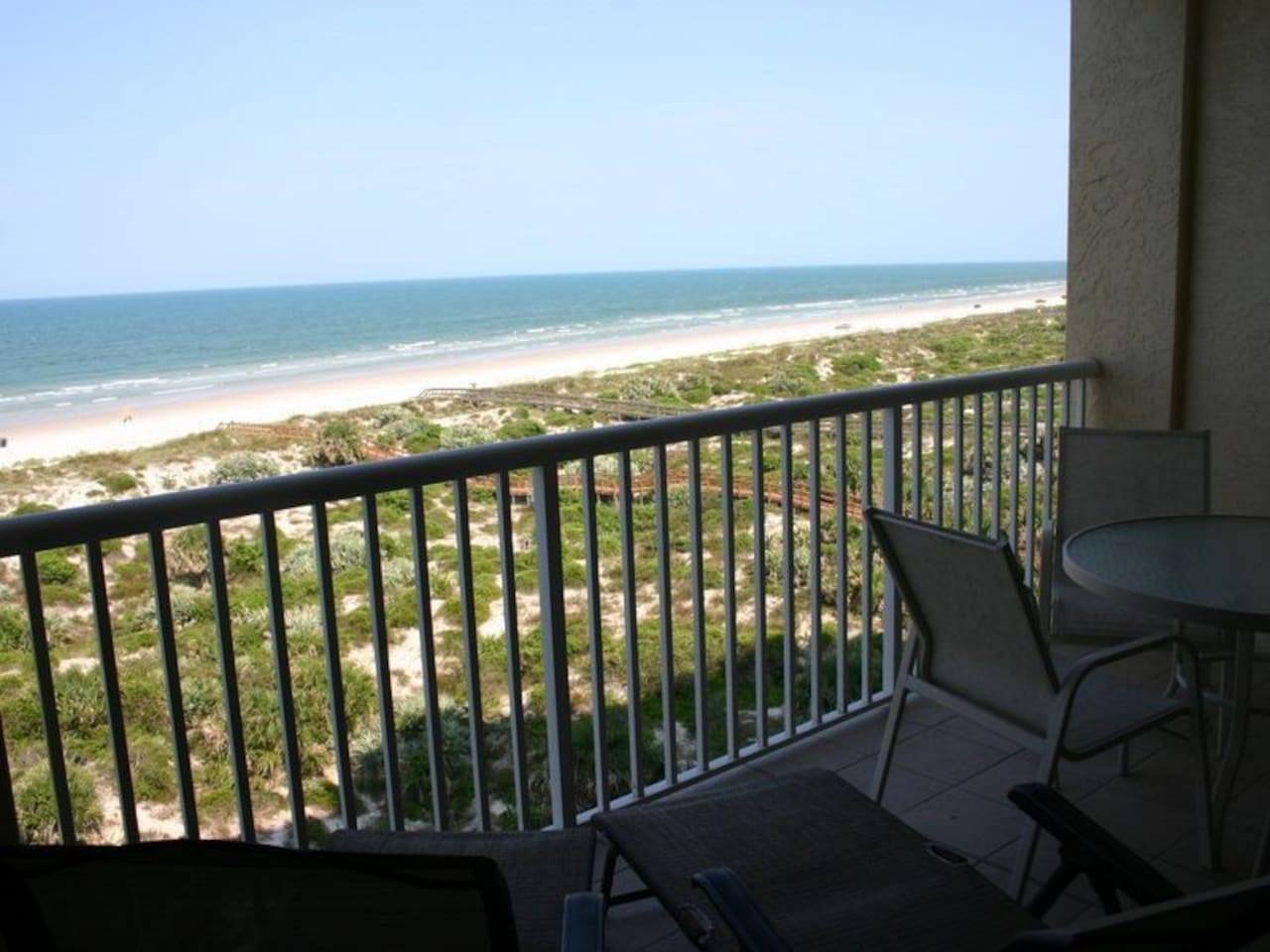 Sit back, relax and enjoy the direct oceanfront views of the white sandy beach.
