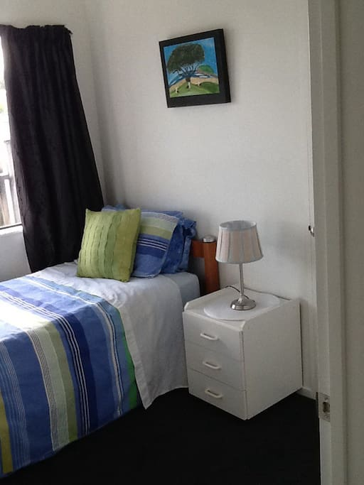Nice sunny room with large wardrobe space.  Very comfortable bed,  new mattress.