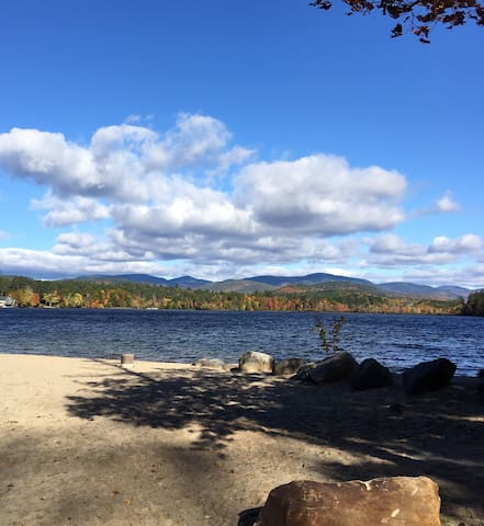 The town beach at Pleasant Point with a view of the White Mountains.