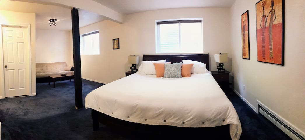 The suite sleeps up to four people. King-size memory foam bed and futon. Suite is on a private floor at the ground level. Blackout shades on the windows.