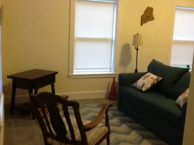 separate space with  cable TV and also DVD , with full sized sleeper sofa