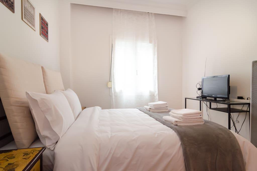 Bedroom 1: - Double bed - Flat TV - Window