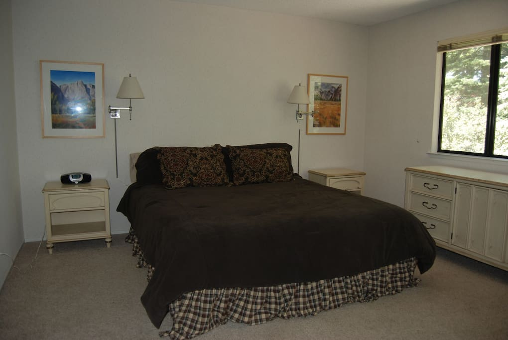 Two bedrooms, including the master shown here, have king-size beds.