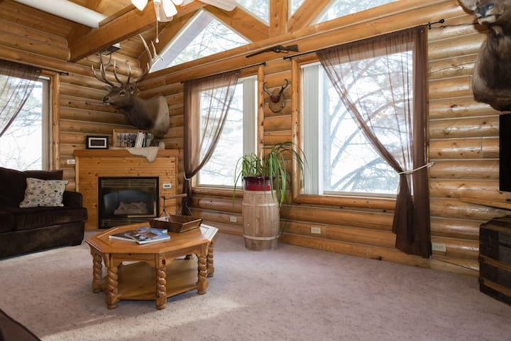 "Nicknamed the ""Tree Room"" Enjoy Gas Fireplace in the corner."