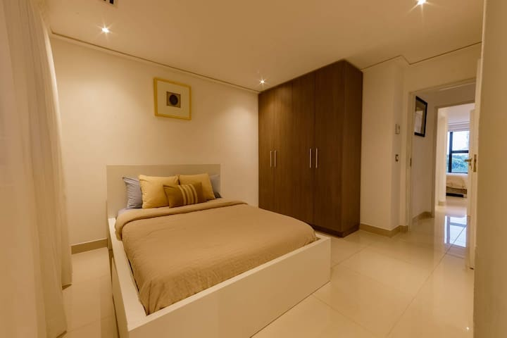 Bedroom 2 with upgraded polished floor.
