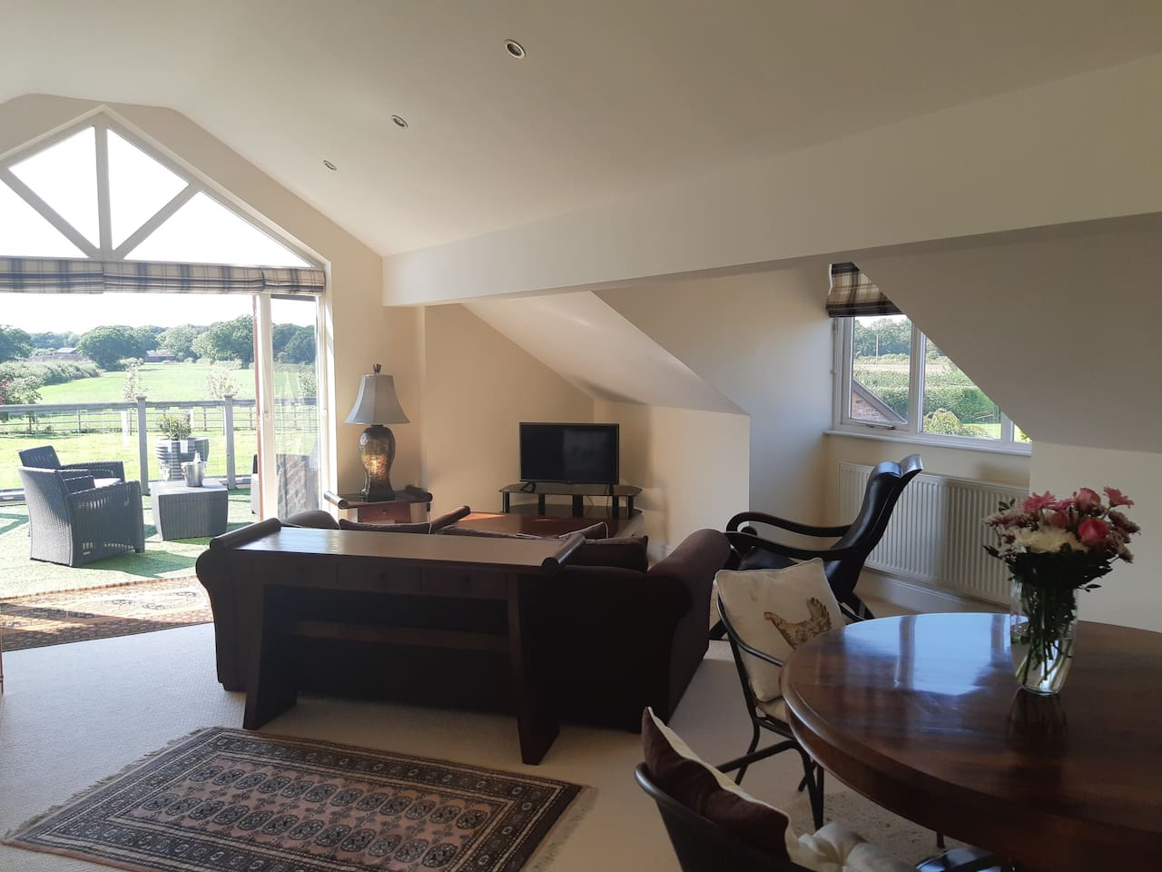 Open plan living area leading to the balcony.