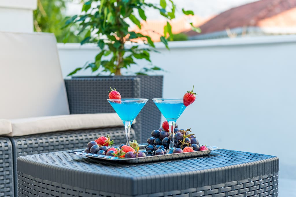 Private terrace with outdoor seating area...