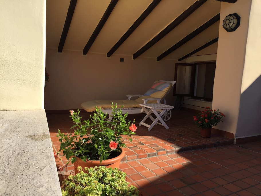 Roof terrace,  partly covered for shade
