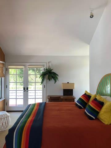 Master Bedroom Suite with Pendleton Blanket & Linen Duvet. Firm Memory Foam Mattress.