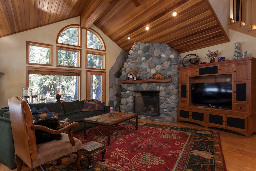 River rock surrounds a large wood fireplace