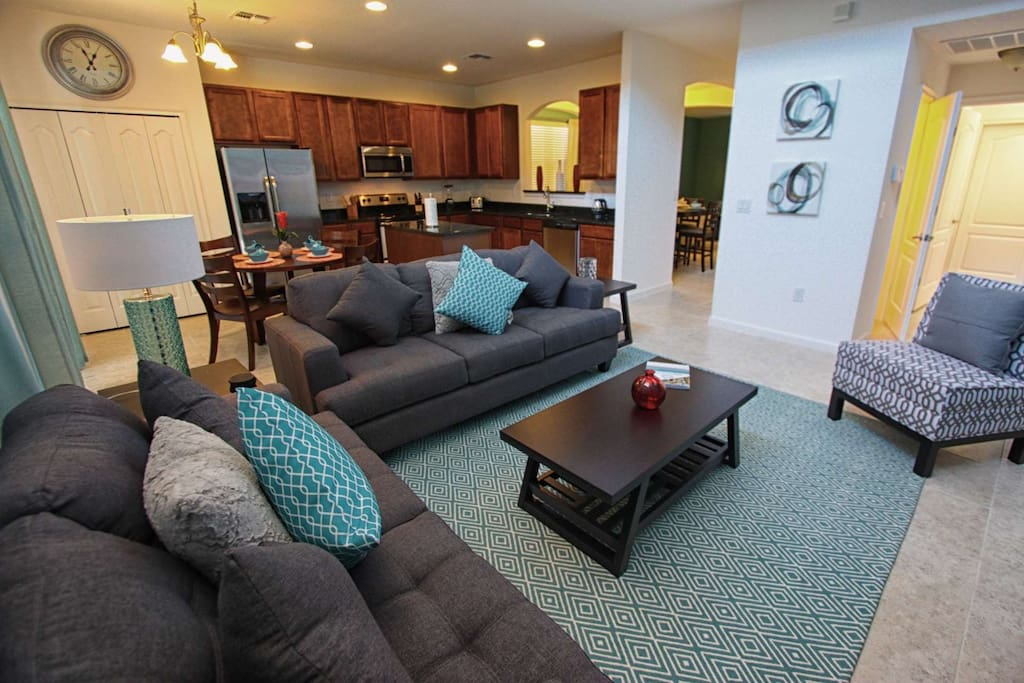 Open Floor Plan featuring Kitchen, Eat In Dining Area & Living Room w/Pool Access