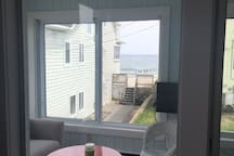 Front enclosed porch with partial ocean views. You can hear the waves
