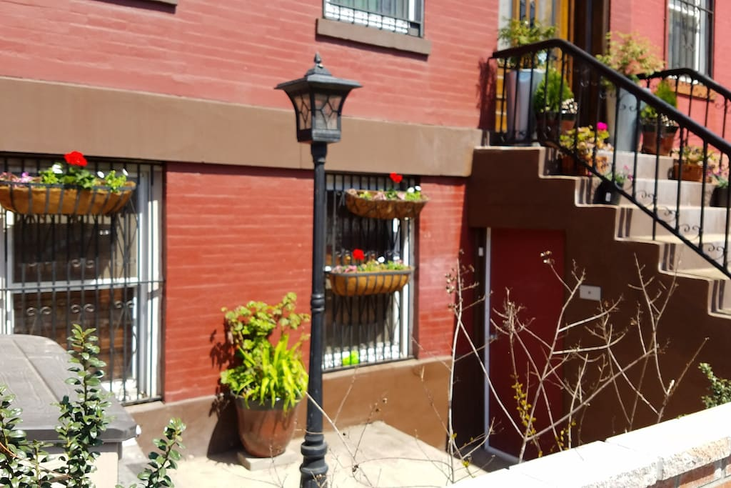 Sunny front patio in Brooklyn brownstone.
