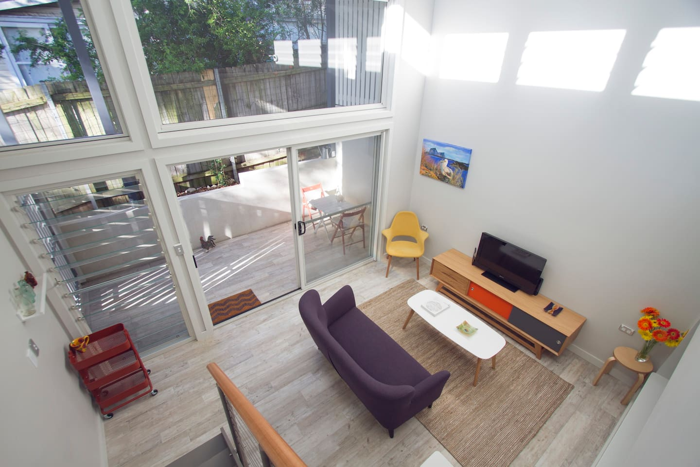 View from stairs to living room and private covered courtyard.