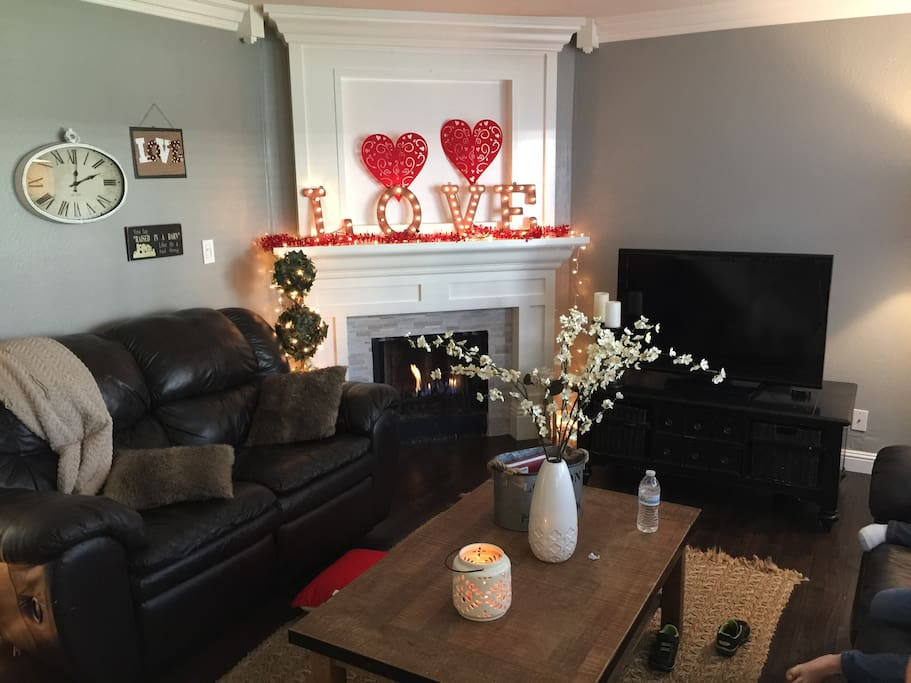 Cozy family area with gas fireplace and 40 inch TV.