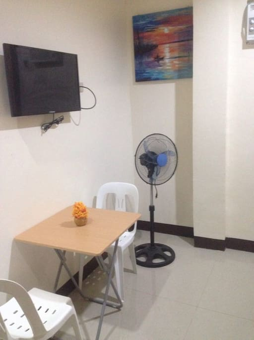 TV, Table and chairs, Fan