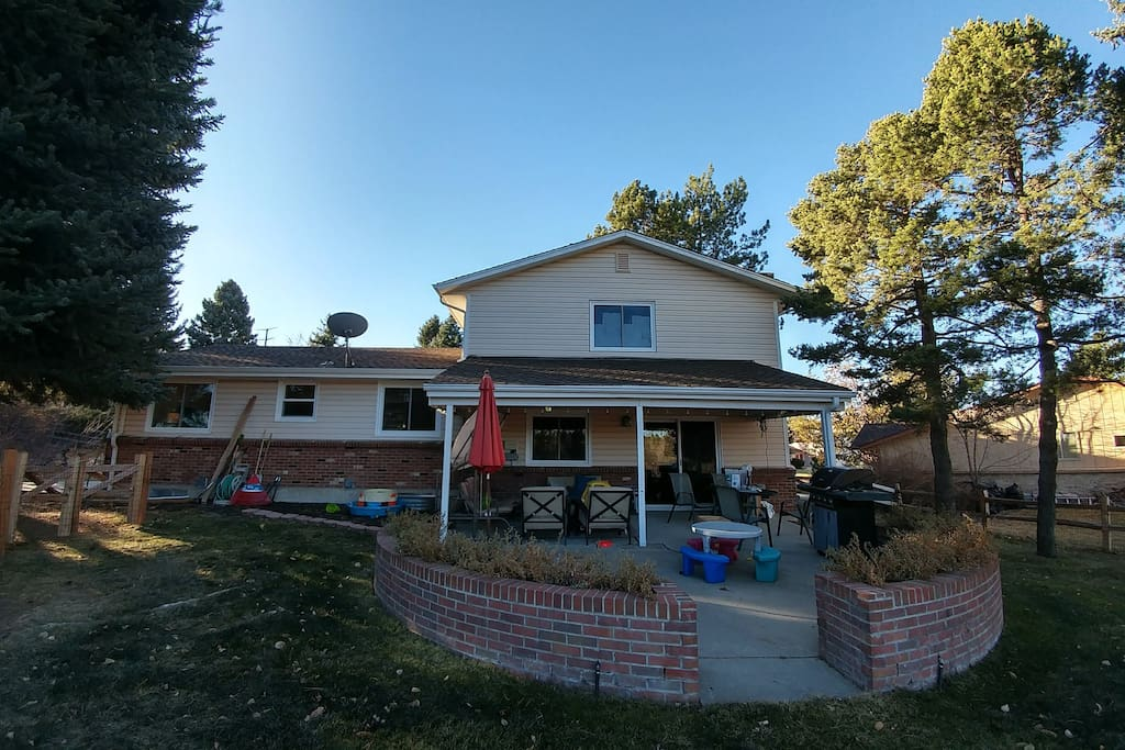 Fenced backyard with patio furniture and grill. Great for relaxing with family.
