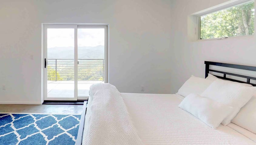 Lower level (3rd) bedroom with private bath and large walk-in closet, fantastic views from the bed looking out the sliding glass door.  Large deck of the bedroom.