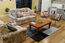 The living, dining and kitchen area is clean bright and spacious. The sofa pulls out to a double bed.